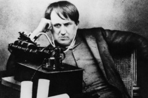 circa 1871:  Thomas Alva Edison (1847 - 1931) American scientist, inventor and industrialist, after spending 5 continuous days and nights perfecting the phonograph, listening through a primitive headphone.  (Photo by Hulton Archive/Getty Images)